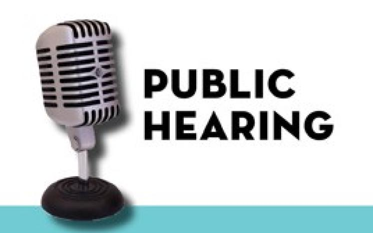 Microphone with words PUBLIC HEARING