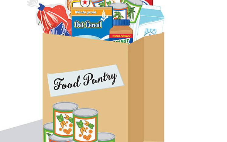 paper grocery bag with food pantry written on if filled with food
