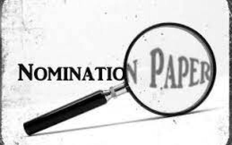 nomination papers with magnifying glass