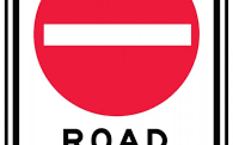 street sign labeled road closed