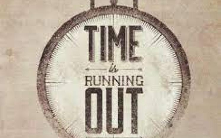 time is running out written on a clock face