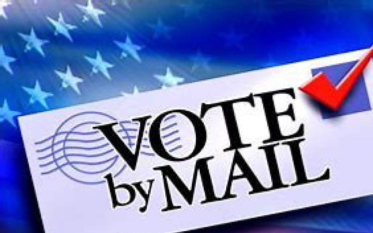 envelope with vote by mail written on it